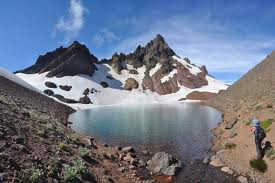 Glacial blue lake hidden among scree and Broken Top peaks