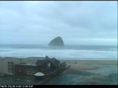 Live web cam February 12, 2014 looking across the cozy Pelican Pub to iconic haystack rock
